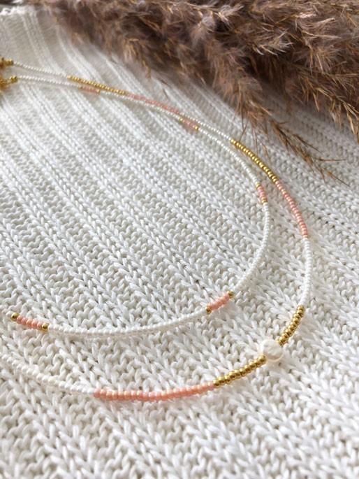 DIY pakket 2x kralenketting wit, roze, goud met zoetwaterparel