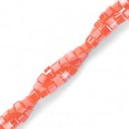 Vierkante cube facetkraal 2x2mm burnt coral pink pearl shine coating