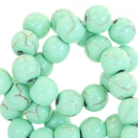 Keramiek turquoise kraal rond 4mm turquoise green