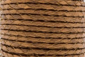 DQ rond gevlochten leer 4mm koper per 20cm