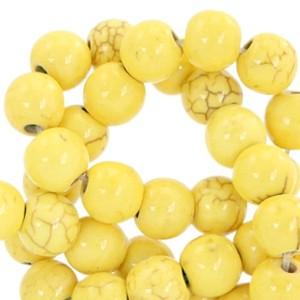 Keramiek turquoise kraal rond 4mm lemon yellow